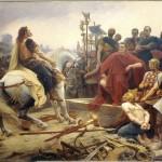 Vercingéˆtorix jette ses armes aux pieds de Céˆsar. Peinture de Lionel Royer, 1899. Cliché et © Le Puy-en-Velay, musée Crozatier.