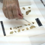 3. Opening the scroll in the IAA labs Credit- Shai Halevi, Israel Antiquities Authority. DR.